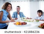 family sitting at breakfast... | Shutterstock . vector #421886236