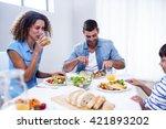 family sitting at breakfast... | Shutterstock . vector #421893202