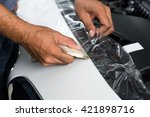 Small photo of Paint protection film series : Installing paint protection film on white car