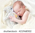 baby sleeping with her teddy... | Shutterstock . vector #421968502