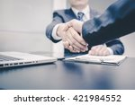 business handshake and business ... | Shutterstock . vector #421984552