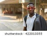 african student outdoors | Shutterstock . vector #422013355