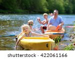 family kayaking on the river.... | Shutterstock . vector #422061166