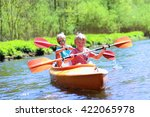 Two Boys Kayaking On The River. ...