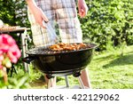 barbecue in the garden | Shutterstock . vector #422129062
