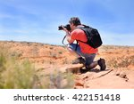 middle age photographer taking... | Shutterstock . vector #422151418