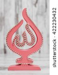 Small photo of Pink Religious statuette with the name of Allah, the God written on it