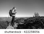 young woman backpacker reaching ... | Shutterstock . vector #422258056