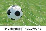 classic soccer ball in goal net ...   Shutterstock . vector #422299348