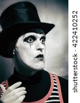 Small photo of Portrait of mad hatter dressed in black topper on white background