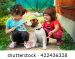 two girls playing with a beagle ... | Shutterstock . vector #422436328