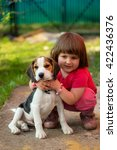 cute little girl with a beagle... | Shutterstock . vector #422436376