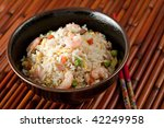 Bowl of Shrimp Stir Fry Rice, Traditional Chinese Food, Dark Background - stock photo