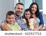 portrait of family sitting on... | Shutterstock . vector #422517712