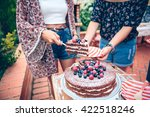 Woman Serving Chocolate Cake I...