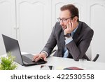 businessman sitting at the desk ... | Shutterstock . vector #422530558