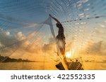 Fisherman Throwing Fishing Net...