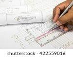 hand holding a pencil  ruler... | Shutterstock . vector #422559016