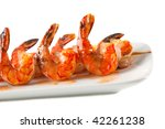 Closeup of BBQ shrimp skewers with sweet garlic chili sauce on white background - stock photo