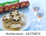 a Christmas still life with mince pies, glasses of sherry and crackers - stock photo