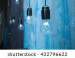 light bulbs hanging on an... | Shutterstock . vector #422796622