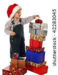 Smiling little boy with lot Christmas gift boxes - stock photo