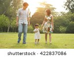 happy asian family walking on... | Shutterstock . vector #422837086
