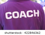 Back Of A Coach's Shirt With...