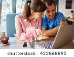young man and woman with laptop | Shutterstock . vector #422868892