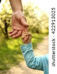 the parent holds the hand of a... | Shutterstock . vector #422913025