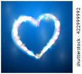 heart with flare on blue... | Shutterstock .eps vector #422999992