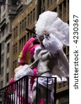 african-american pride parade participant of pride parade in New York in white feathered costume - stock photo