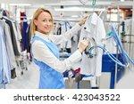 girl worker laundry ironed...   Shutterstock . vector #423043522
