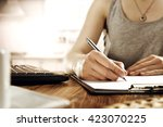 pen hands and laptop  | Shutterstock . vector #423070225