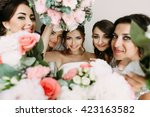 pink flowers and bride's face... | Shutterstock . vector #423163582