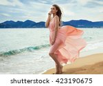 beautiful unusual woman walking ... | Shutterstock . vector #423190675