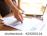 business people analyzing graph ... | Shutterstock . vector #423203116