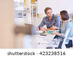 business man and woman working... | Shutterstock . vector #423238516