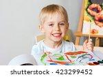 happy cheerful child draws... | Shutterstock . vector #423299452
