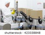 worker in apron  cap with... | Shutterstock . vector #423338848