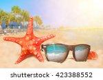 beach. starfish and sunglasses... | Shutterstock . vector #423388552