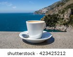 cup of coffee at the seaside of ...   Shutterstock . vector #423425212