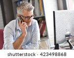 businessman in office talking... | Shutterstock . vector #423498868