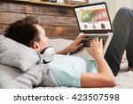 man sitting at home using a... | Shutterstock . vector #423507598