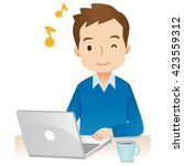 young man enjoy using laptop... | Shutterstock . vector #423559312