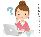 young woman using laptop... | Shutterstock . vector #423559315