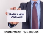 man showing paper with learn a... | Shutterstock . vector #423581005
