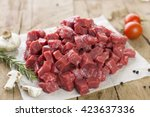 diced beef on wooden background ... | Shutterstock . vector #423637336