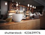 white cup of coffee at the cafe ... | Shutterstock . vector #423639976