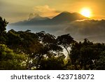 sun setting over fuego volcano  ... | Shutterstock . vector #423718072
